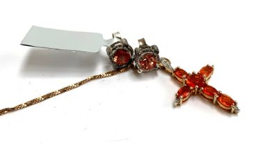 A 925 silver gilt crucifix set with white and orange stones, the 925 silver chain approx. 45cmL;
