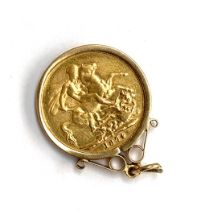 A Victorian gold sovereign, 1874, in 9ct gold mount, 9.2g