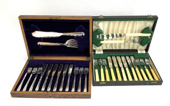 A cased set of fish knives and forks, with bone handles; together with one other similar