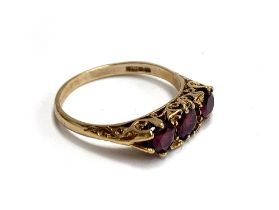 A 9ct gold ring set with three brilliant cut rubies, size P, 2.7g