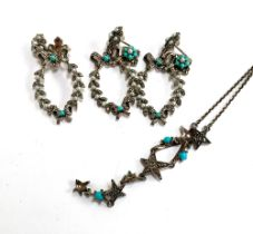 A white metal necklace set with marcasites and turquoise, the chain marked 925, approx. 40cmL;