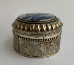 A continental silver lidded pot, with blue and white Delft ceramic windmill to top, 9cmD