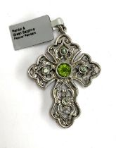 A Stephen Whittard pierced pewter cross set with peridots and green sapphire, 6cmL