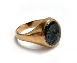 A 9ct gold signet ring, designed with an oval hematite intaglio depicting a gentleman in profile