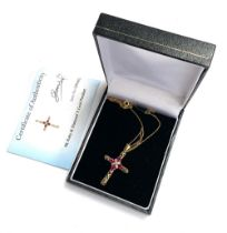A 9ct gold pierced crucifix set with four rubies and a diamond, approx. 2.75g, with box