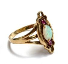 A 9ct gold ring set with opal and two small rubies, size R, 2.8g