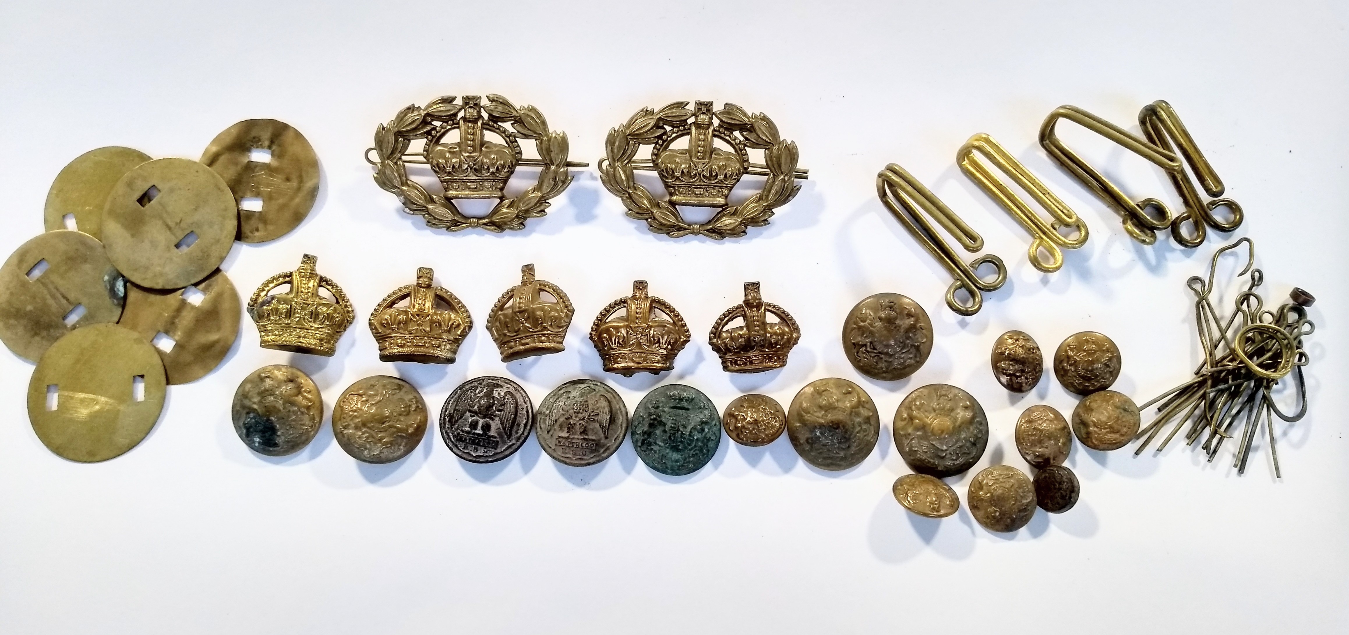 Two British Army Warrant Officer brass rank crown sleeve badges; together with five British Army