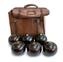 A Slazenger bag containing four lawn bowls by RW Hensell & Sons, made in Australia, 'Henselite'; a