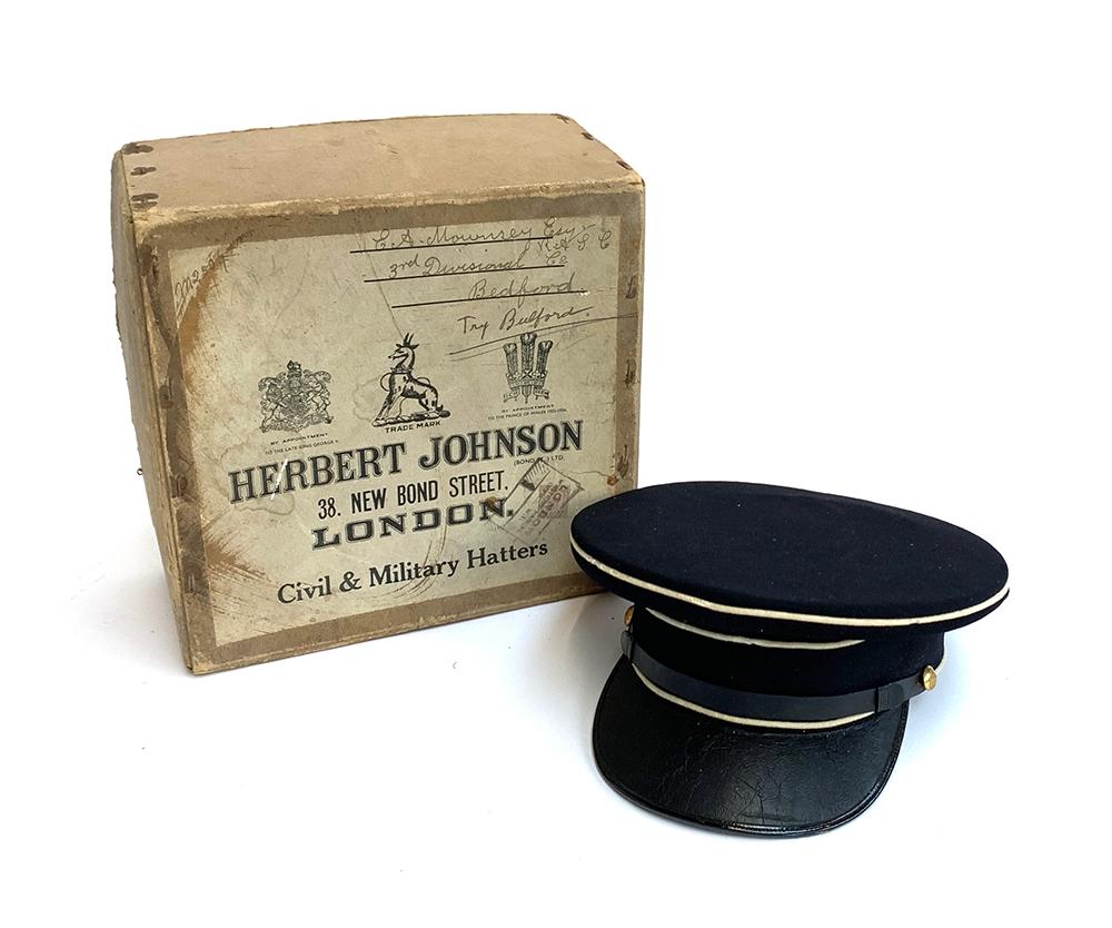 A military peeked cap from Herbert Johnson, in original box