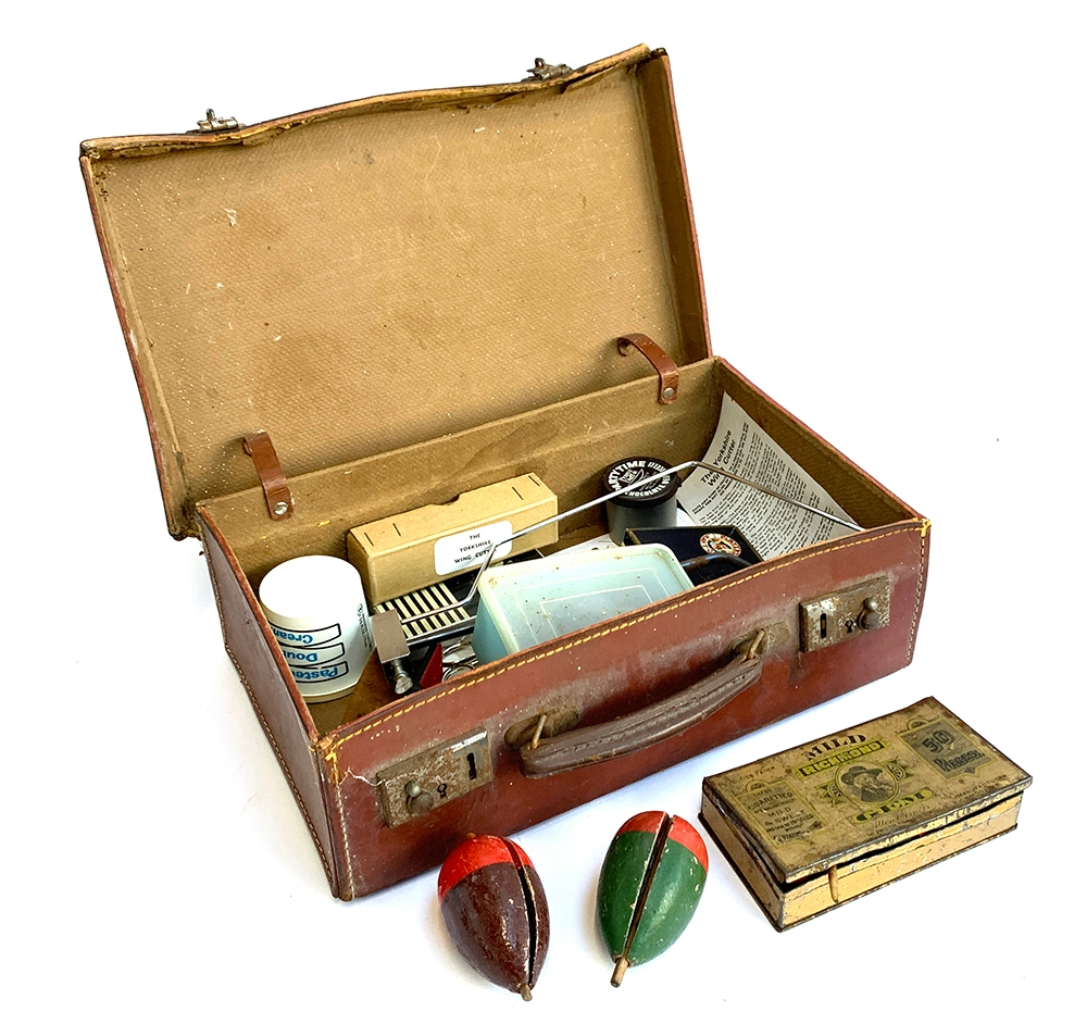 A brown leather overnight case containing a quantity of vintage fly tying equipment, in particular a