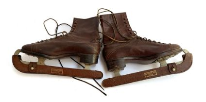 A pair of vintage ice skates, Lilley & Skinner 'The Ice Boot' with Queens Ice Club blade guard