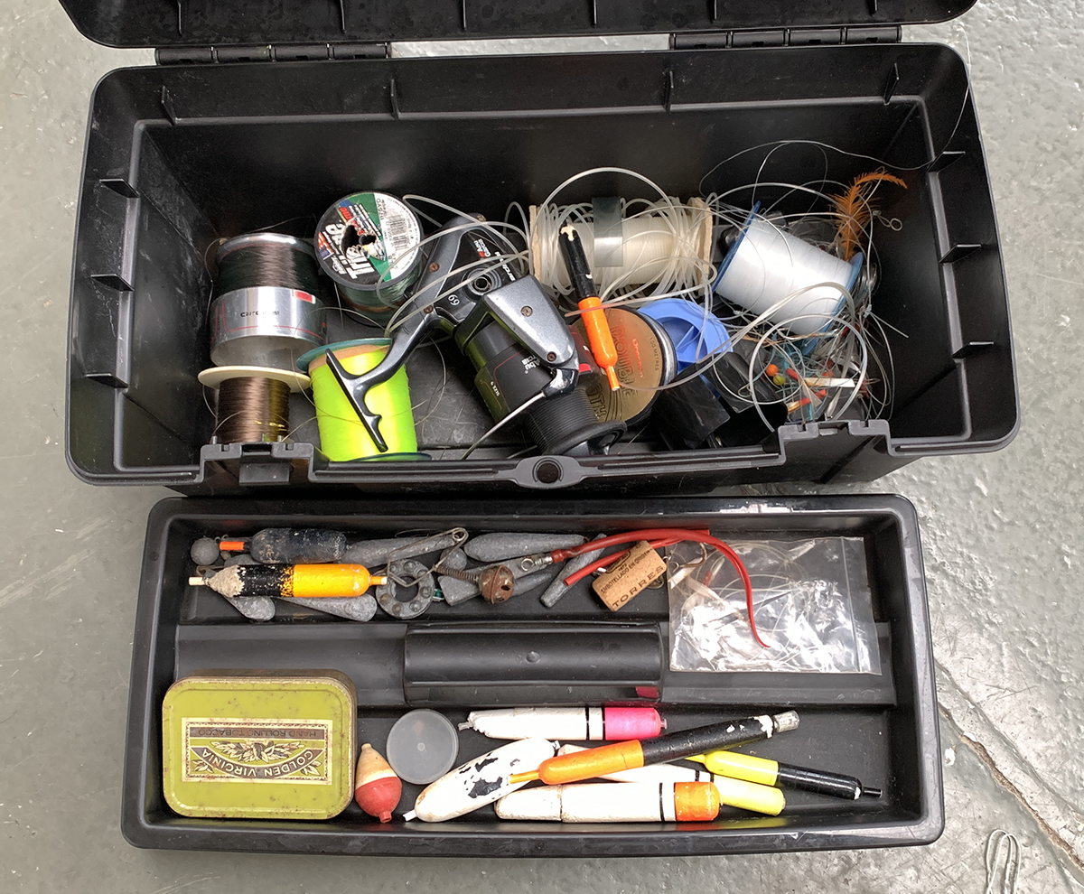 A Zag tackle box, containing a number of sea fishing floats and weights, together with an Abu