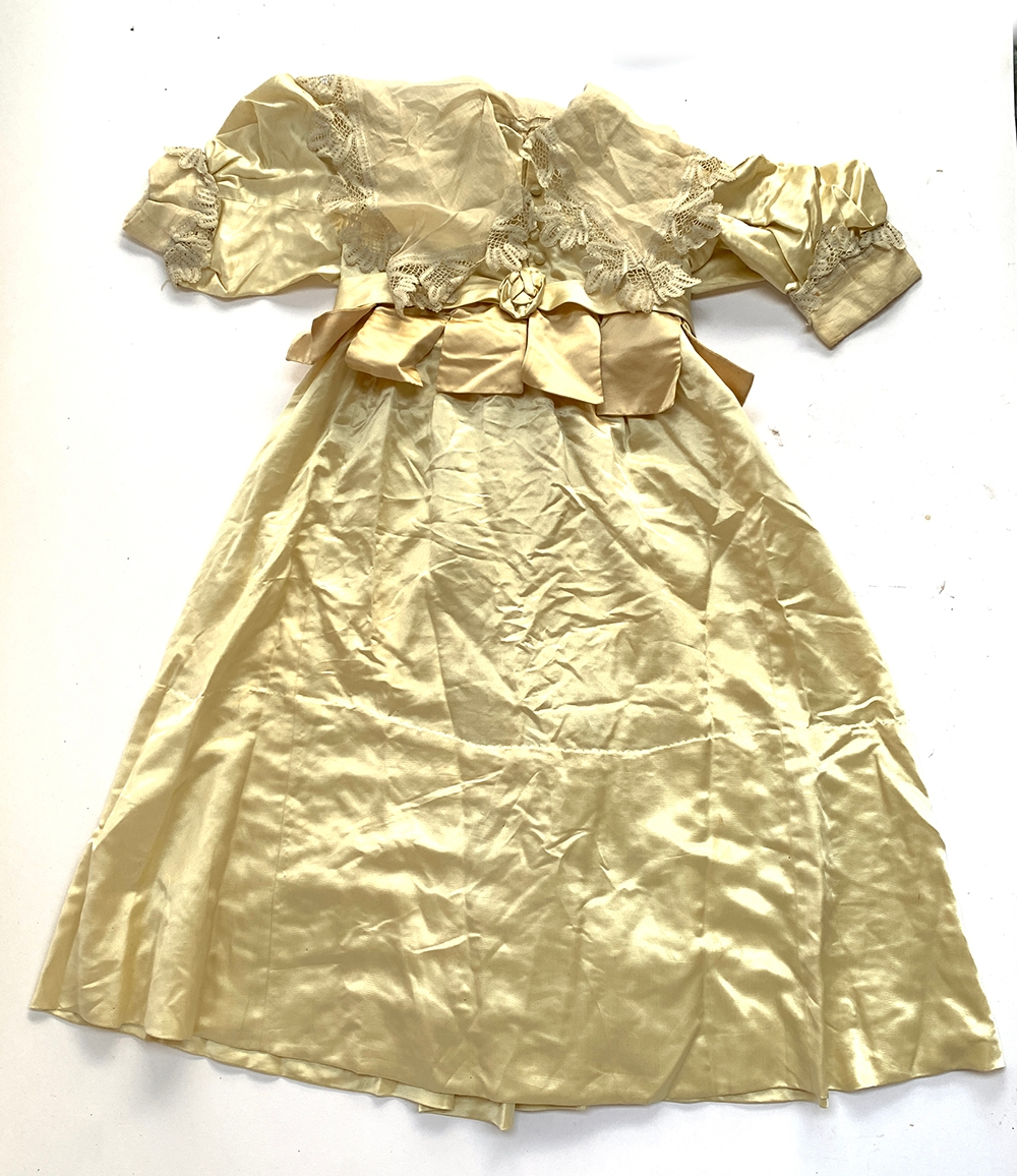 A satin child's dress, early Victorian, with lace collar