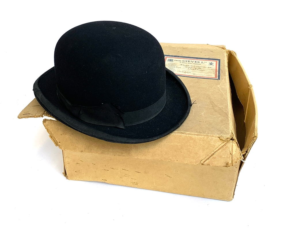 A Gieves of London black bowler hat with original box, size 7 1/4, 20.5x16.5cm