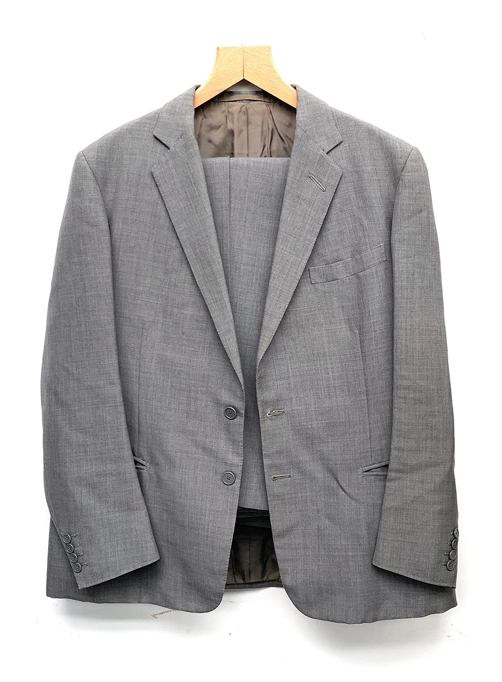 A gent's single breasted wool suit with two pairs of trousers, tailored by Sullivan, Woolley &