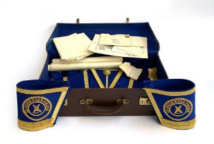 Masonic interest: a brown leather suitcase lined in blue, containing a turquoise sash; a