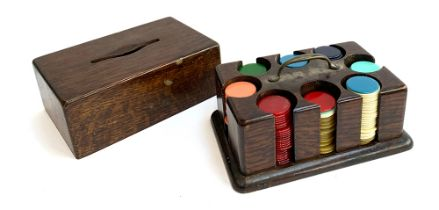 An oak gaming chip holder, with brass handle, having eight slots, containing a quantity of counters,