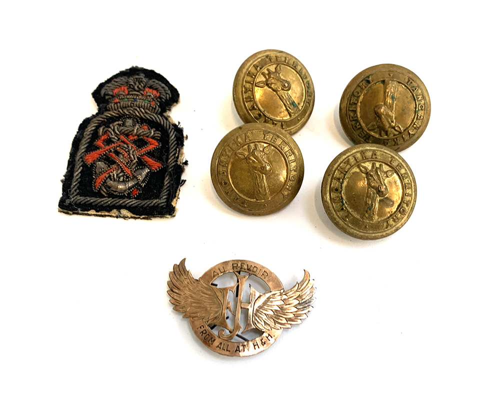 Four brass buttons featuring a giraffe and the inscription ?Tanganyika Territory? by Firmin London