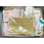 A box of miscellaneous materials, table cloths, and table runners, mostly unused