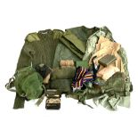 A mens heavy olive drab round neck size 100 military issue jersey; together with a pair of foul