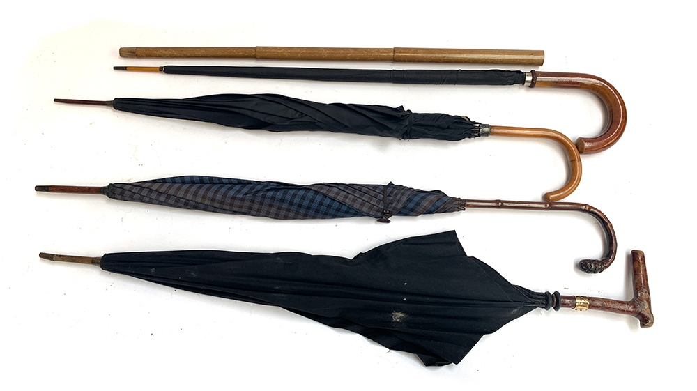 A gent's umbrella with collapsible telescopic outer cover; together with one other by James