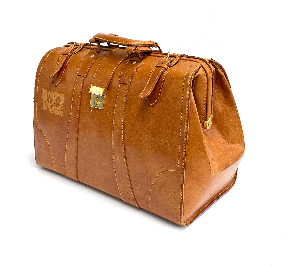 A tan leather briefcase