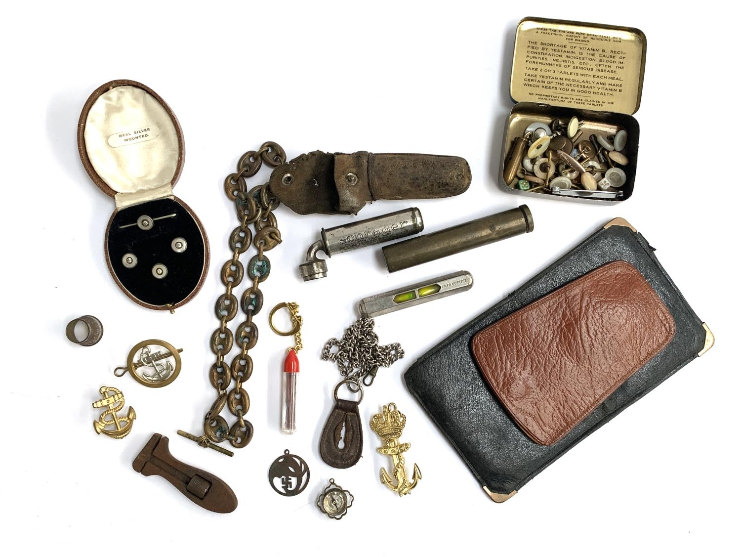 A mixed lot of interesting things to include trench art fob chain; a collection of buttons; brass