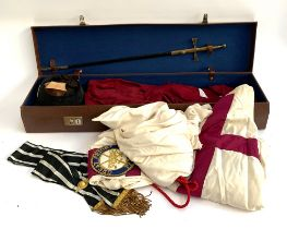 Masonic interest: a brown leather suitcase containing a Toye Kenning & Spencer hooded cloak with
