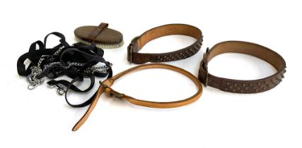 Two large studded mastiff collars and one other, together with leads and body brush for grooming