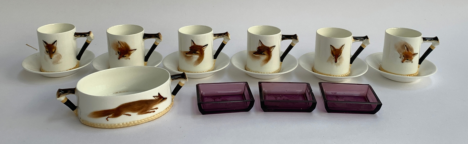 A set of six Royal Doulton 'Reynard the Fox' coffee cans with saucers and a sugar bowl; together