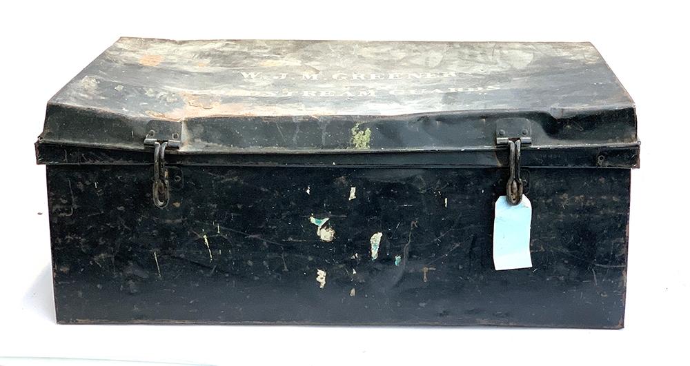 A black metal tin travel trunk, the top marked 'W.J.M Greener, Coldstream Guards', 92x53x37cm