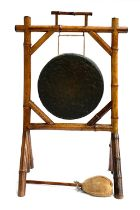 A British Army tiger bamboo dinner gong, 82cm high, the brass drum 32cm diameter