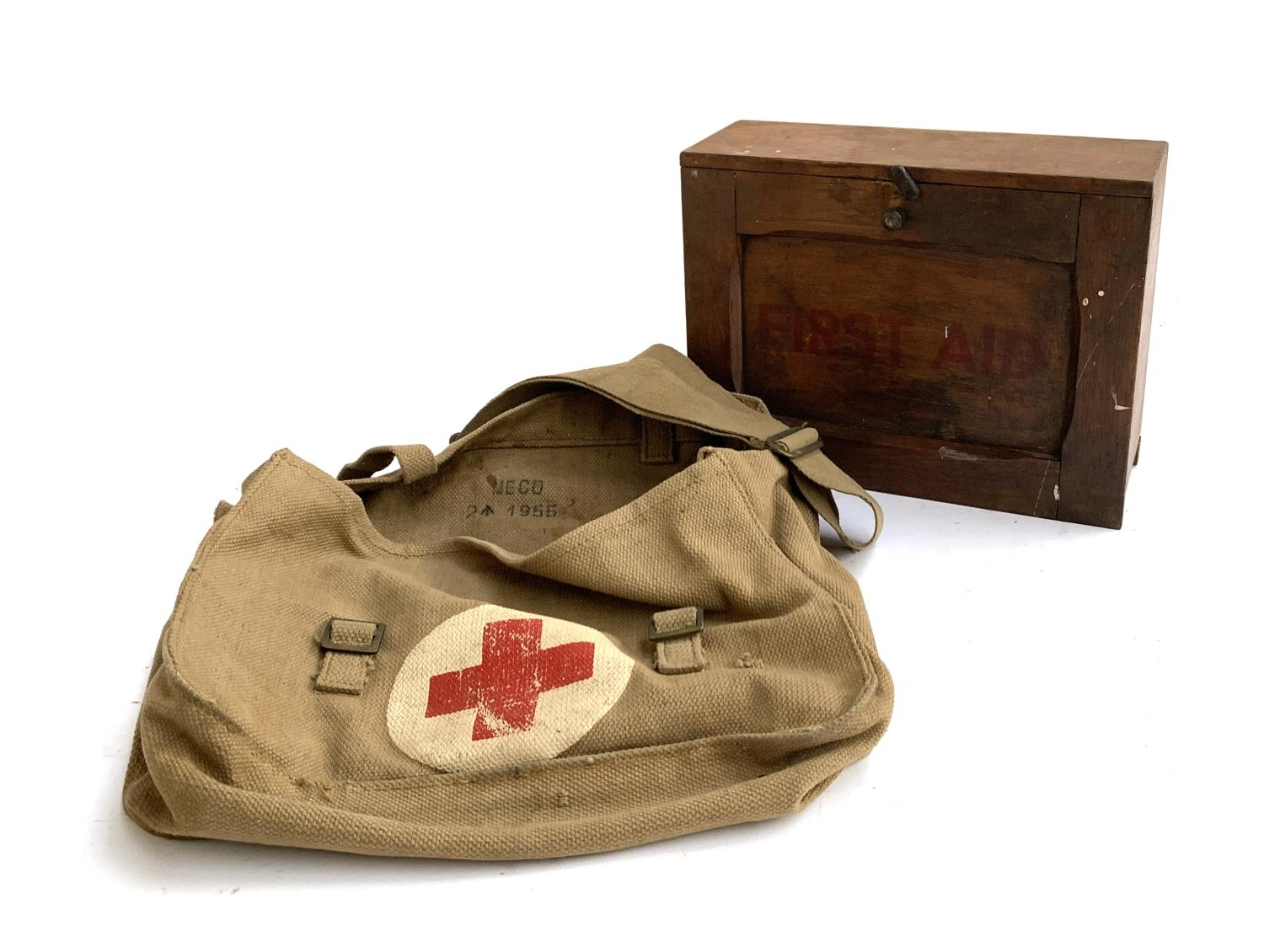 A 1950s military canvas first aid bag and fitted cabinet, 28cmW