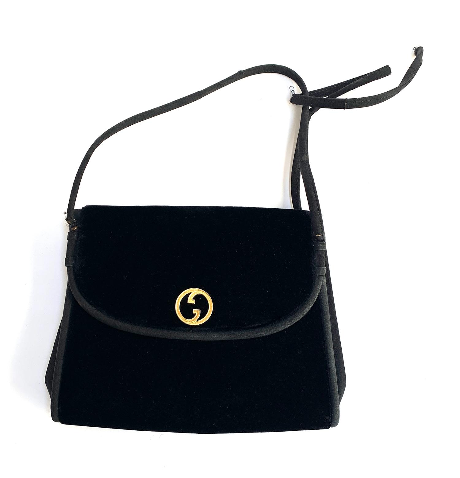 A Gucci black evening bag with Gucci clip case (af)