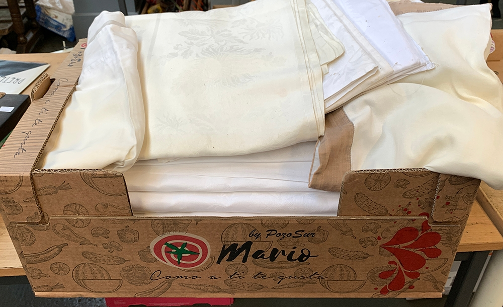 A large box of linen and damask tablecloths, and some other to include The White Company