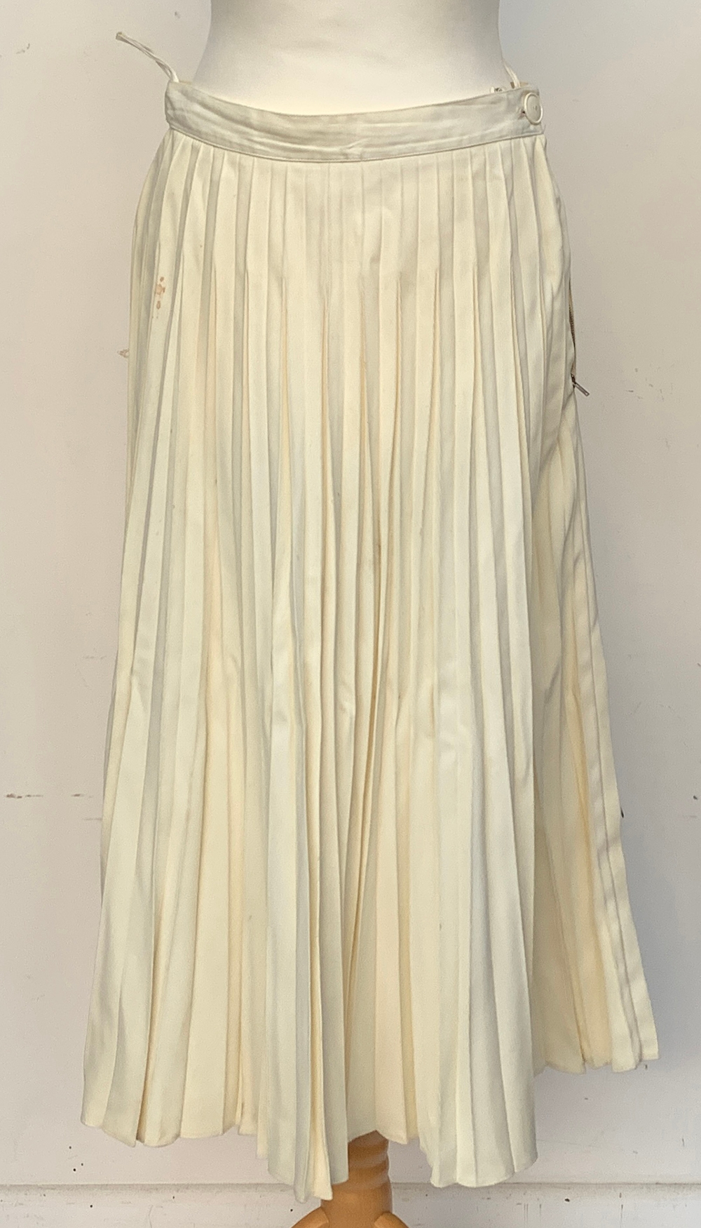 A vintage Lilywhites tennis skirt, together with an underskirt, hooped skirt, etc, in a large