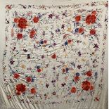 A heavy profusely embroidered 19th century shawl, the central panel approx. 130x130cm, all round