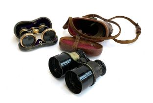 A pair of late 19th/early 20th century small binoculars in a leather case; together with a pair of