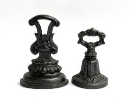 Two cast iron Coalbrookdale style door stops, 23cm high and 18cm high (2)