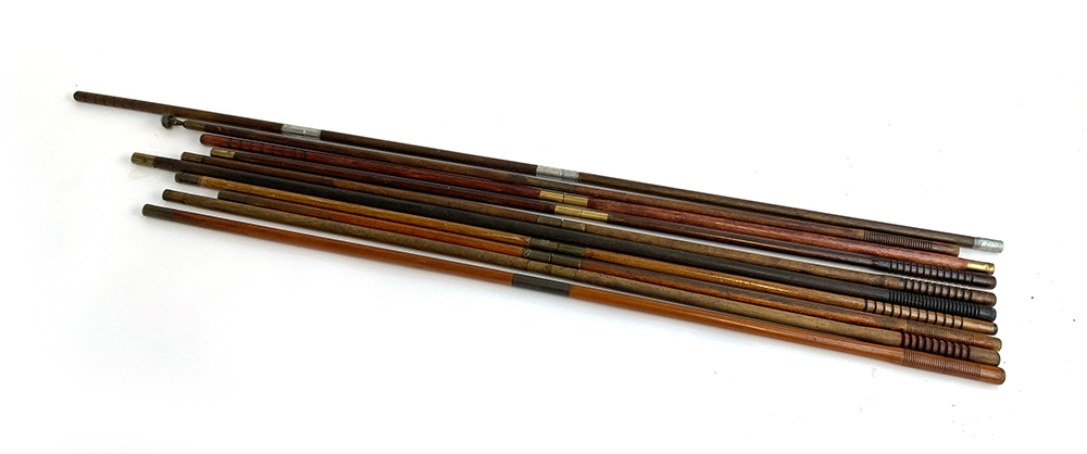 A lot of ten various gun cleaning rods, mostly two piece