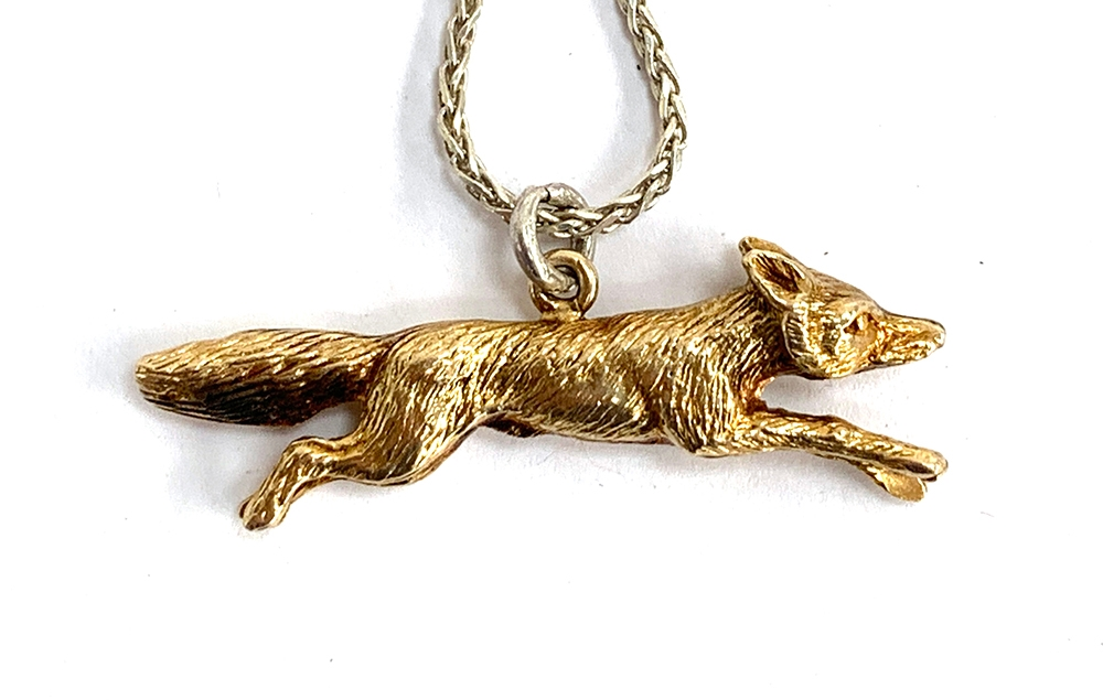 An Asprey 9ct gold running fox, on a .925 silver chain, marked London 1967, approx. 6.9g