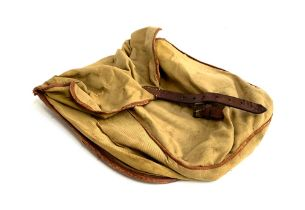 A canvas and leather falconer's bag