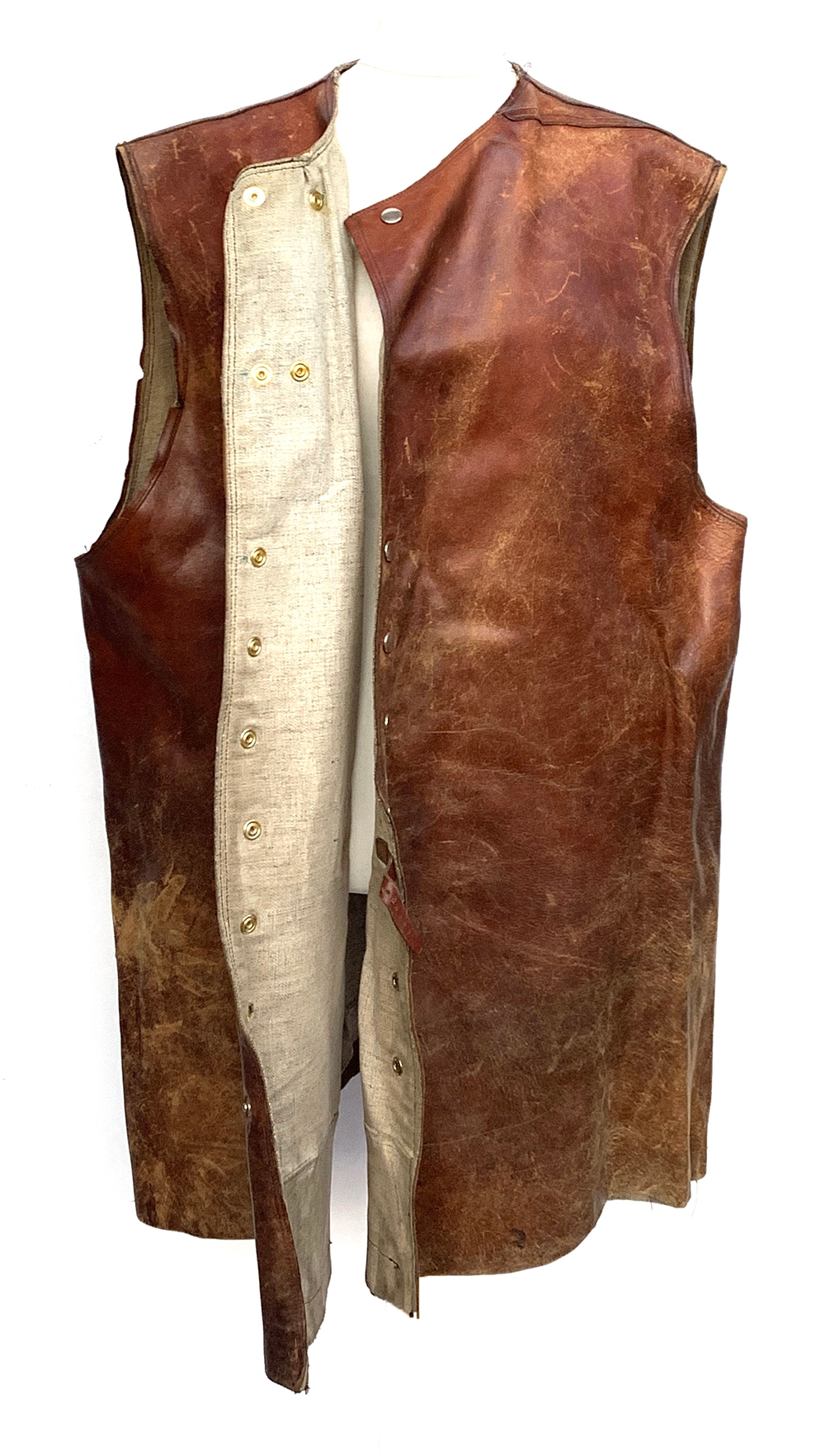A leather and canvas jerkin, very large; together with a pair of twill jodhpurs with side