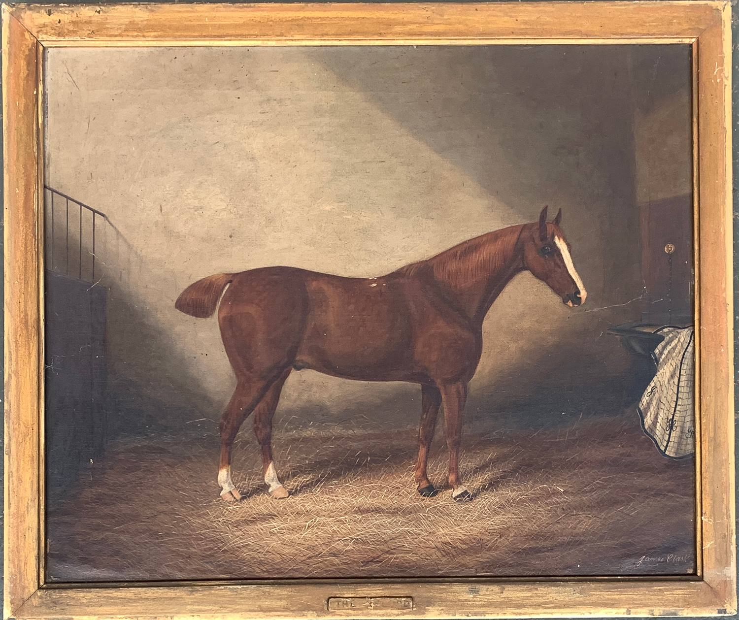 James Clark (British 1858-1943), A Liver Chestnut Hunter 'The Record' in a Stable with a Blanket,