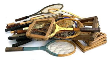 A quantity of vintage tennis and squash rackets, including Dunlop, together with some vintage