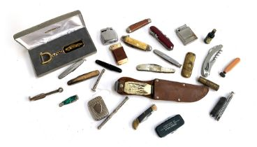 A mixed lot of penknives, lighters, plated vesta case, etc