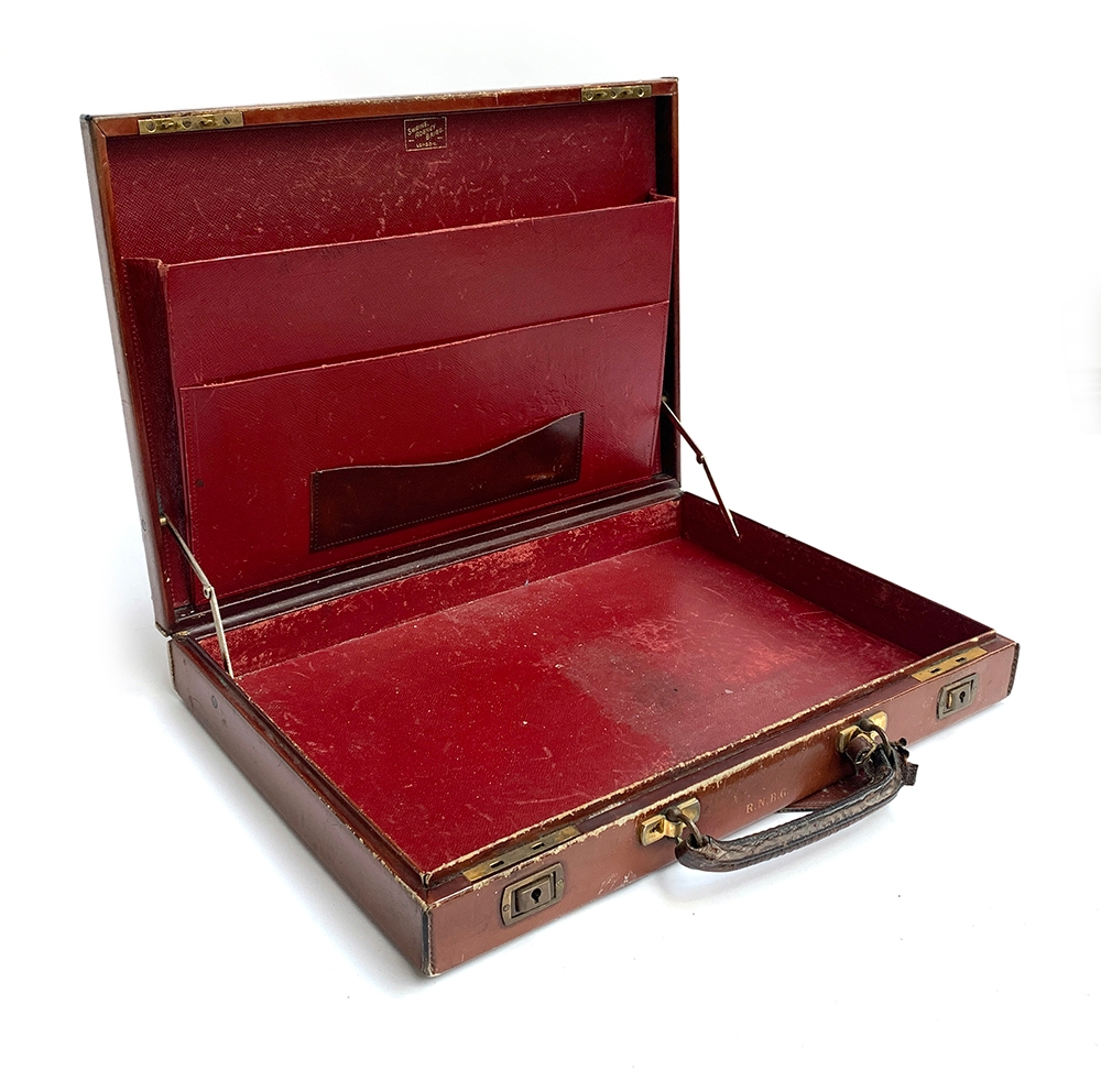 A gent's brown leather writing case, by Swaine, Adeney & Brigg, with fitted red leather interior,
