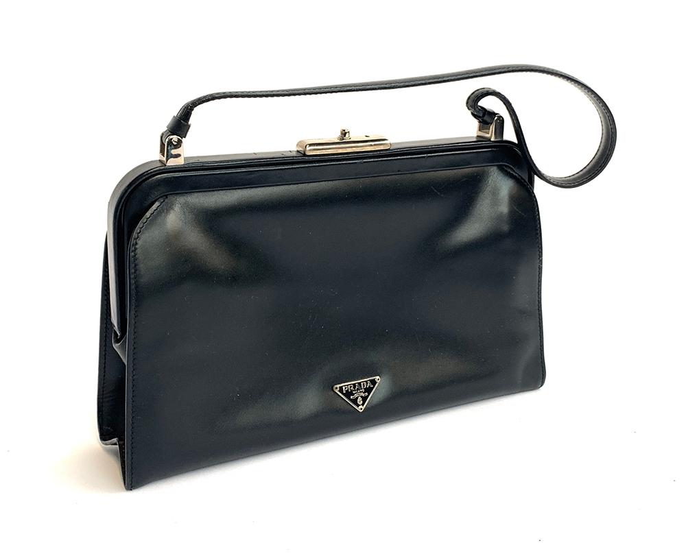 A Prada black leather handbag, with felt dust bag