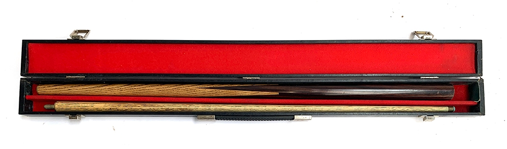 A two piece snooker cue in carry case