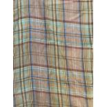 Two unmade curtain lengths of light tartan tweed